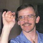 Photo of Bob Sinaeve preparing to throw a dart