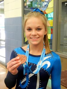 Photo of Haven Swarts with medal